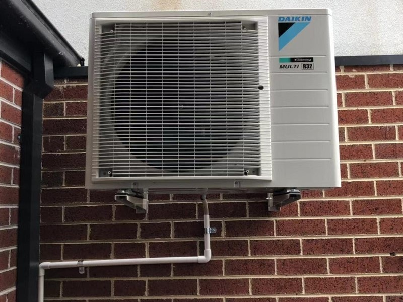 Daikin on wall bracket and drain